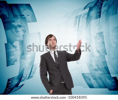 business person with virtual digital screens all around - stock photo