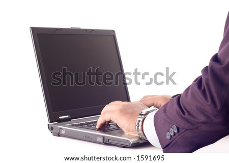 Business person working on a lap top computer against white background