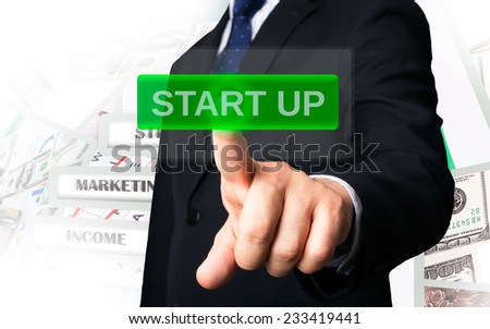 Business person working with modern virtual technology (screen start up button)