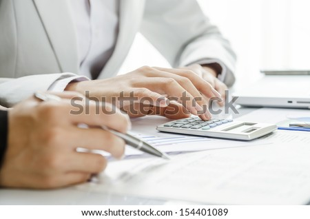 Business persons discussing on financial figures - stock photo