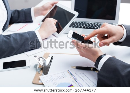 Business, phone, laptop.