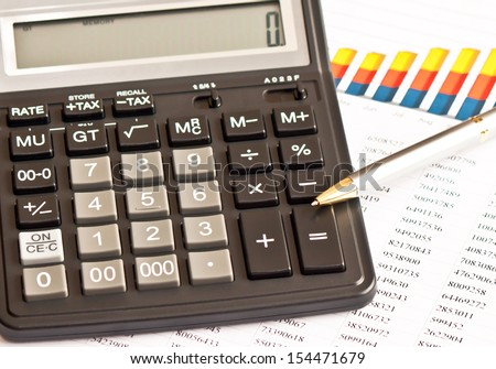 Business picture: calculator, financial graphs, pen  - stock photo