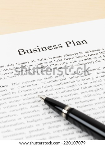 Business plan document with pen