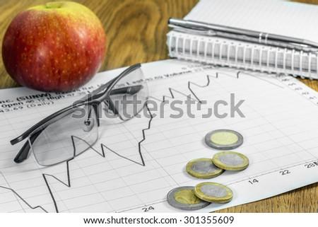 business plan graphics pen glasses apple planning - stock photo