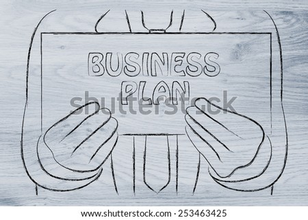 Business Plan sign in the hands of a business man  - stock photo