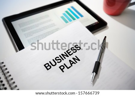 Business plan strategy with touchscreen presentation. - stock photo