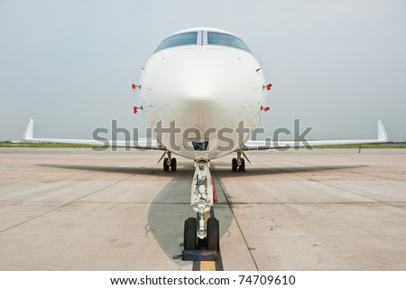 business plane parked at the airport - stock photo
