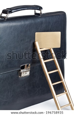 Business portfolio with a gold credit card and staircase - stock photo