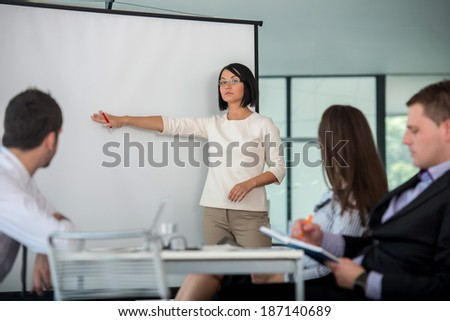 Business presentation in company on copy space whiteboard - stock photo