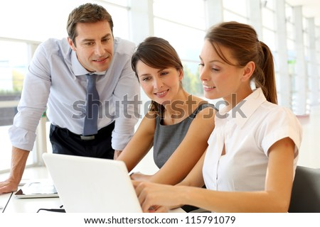 Business presentation on laptop computer - stock photo