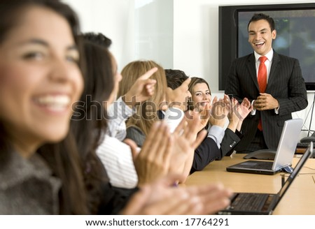 Business presentation or meeting success in an office - stock photo
