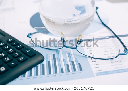 Business presentation with globe and chart on the desk. - stock photo
