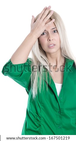 Business pressure: frustrated pretty young blond woman in green blouse is touching her head isolated on white background - stock photo
