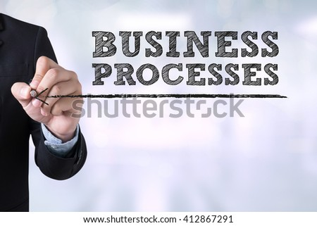 BUSINESS PROCESSES Businessman drawing Landing Page on blurred abstract background - stock photo