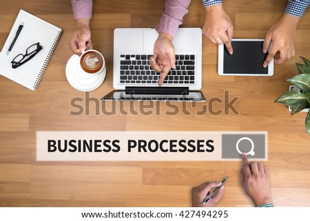 BUSINESS PROCESSES man touch bar search and Two Businessman working at office desk and using a digital touch screen tablet and use computer, top view - stock photo