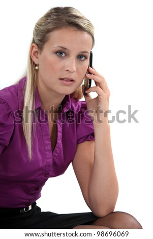 Business professional talking on her mobile phone - stock photo