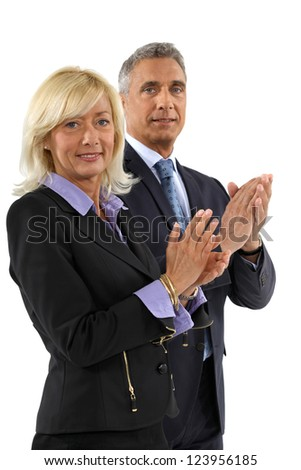 Business professionals clapping their hands - stock photo