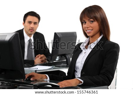 Business professionals working behind their desks - stock photo