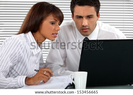 Business professionals working together - stock photo