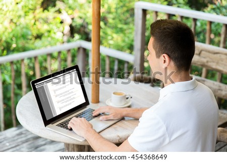 business, programming, people and technology concept - close up of businessman typing on laptop computer with coding on screen outdoors on summer terrace and drinking coffee - stock photo
