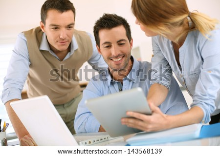 Business project presentation on digital tablet - stock photo