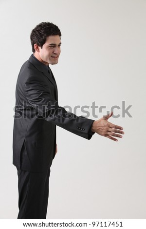 business raised arm about doing a hand shake - stock photo