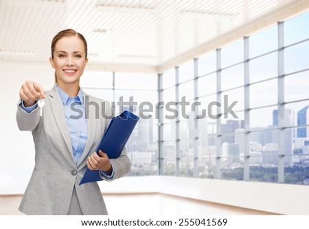 business, real estate, banking and people concept - smiling businesswoman with folder and keys over office room or new apartment background - stock photo
