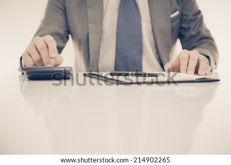 business report and man hand. Accounting - stock photo