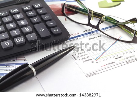 Business report with diagrams, charts and numbers