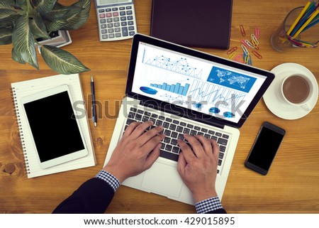 Business Research Data Economy Close up of business man hand working  laptop computer on wooden desk - stock photo