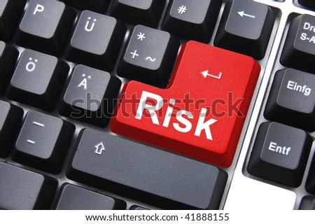 business risk management with computer keyboard enter button