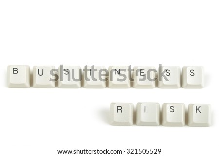 business risk  text from scattered keyboard keys isolated on white background