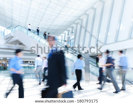 Business Rush Hour in Office Building - stock photo