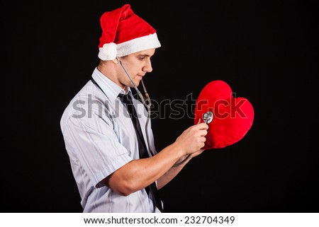 business santa claus with red heart - stock photo