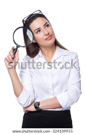 Business search concept. Thinking business woman holding magnifying glass looking away at blank copy space, isolated over white - stock photo