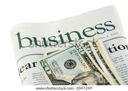 Business section of a newspaper and dollars