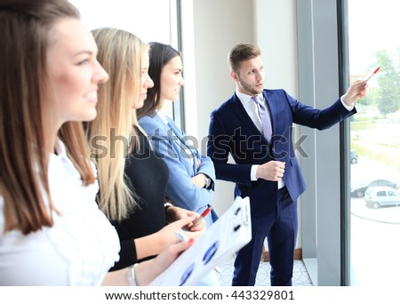 Business seminar where a boss explaining the company strategy to his colleagues - stock photo