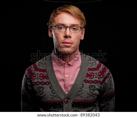 business sexy smart charming guy in a gray sweater and glasses on a black background