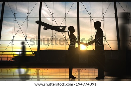 Business shake hand with airplane silhouettes