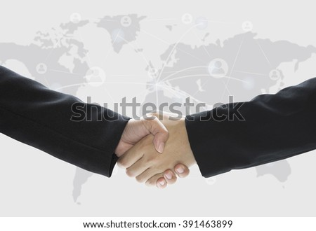 Business shaking hand on world map background.