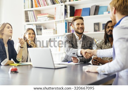 Business shaking hand with a client in office - stock photo
