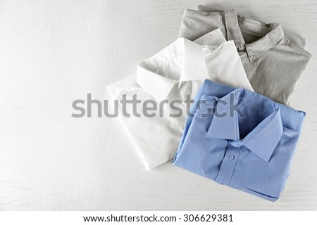 Business shirts on white table - stock photo