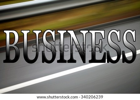 Business sign, for themes of business transport costs, or business planning, start up, getting business up and running and on the go, with road background blurred for motion.