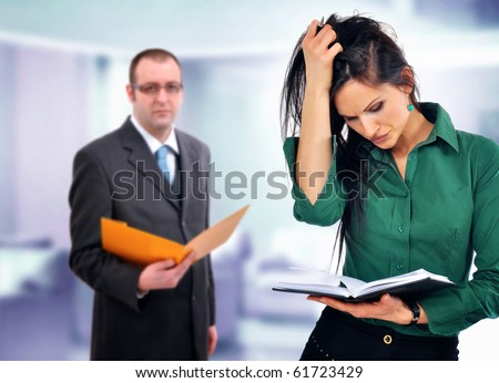Business situation, manager  having doubts about young female employees skills