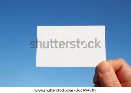 business sized white card in the blue sky - stock photo