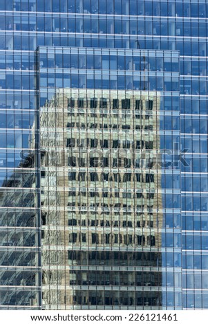 Business skyscrapers reflecting in windows other skyscrapers