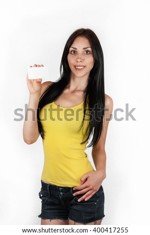 Business smiling girl holds up a white  blank card - stock photo