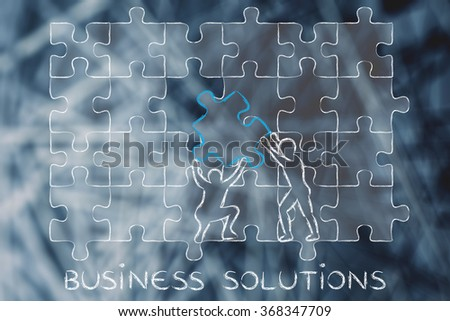business solutions:  men completing a jigsaw puzzle with the missing piece