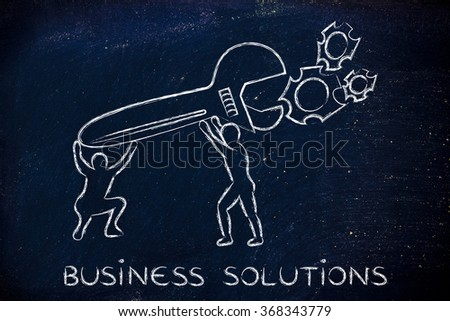 business solutions: men with huge wrench repairing a gearwheel mechanism - stock photo