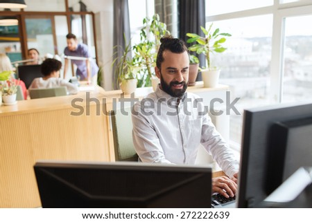 business, startup and people concept - happy businessman or creative male office worker with computer - stock photo